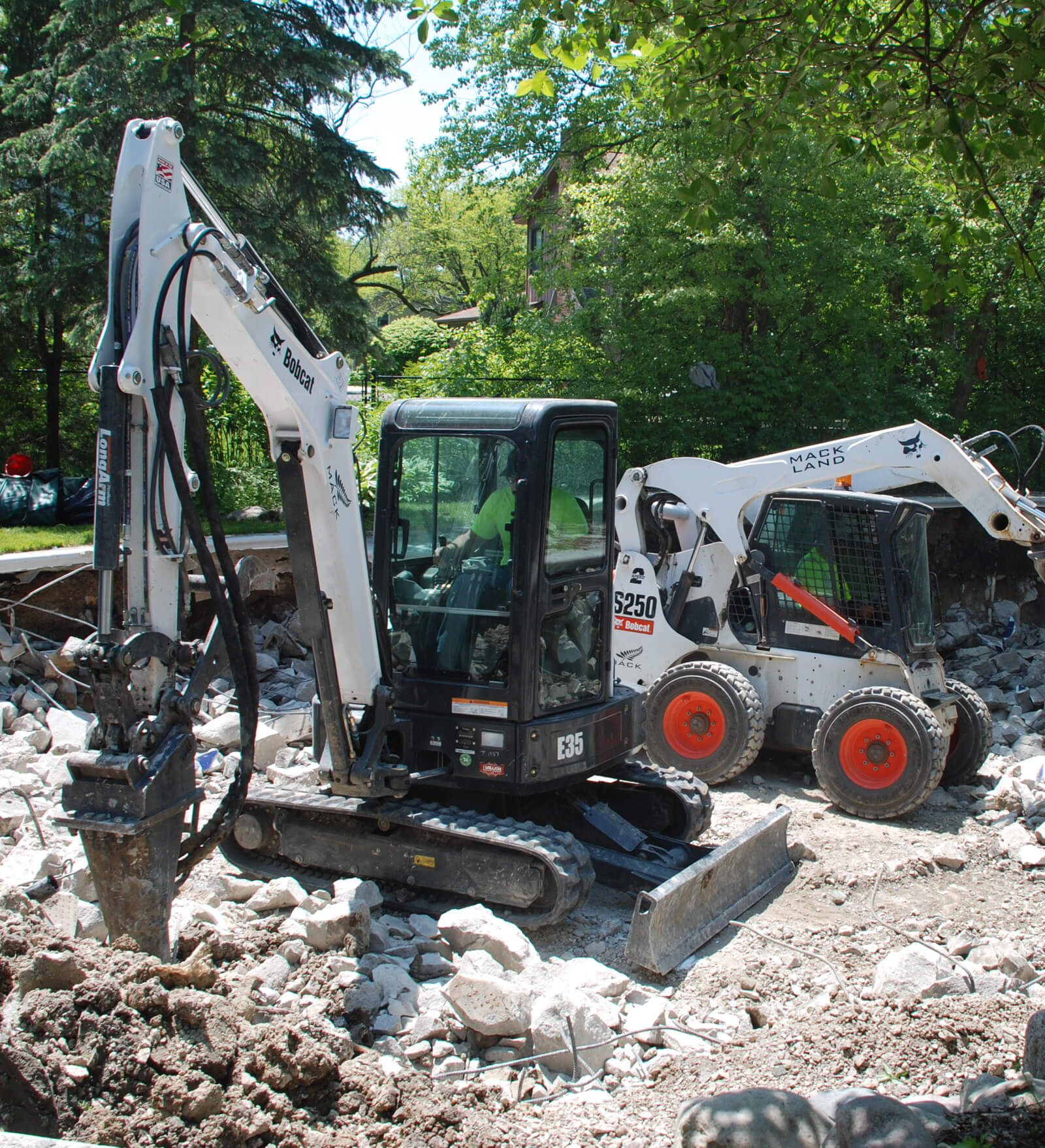Mack Land Compact Excavator Landscape Architects Wauconda Denver Pool Removals