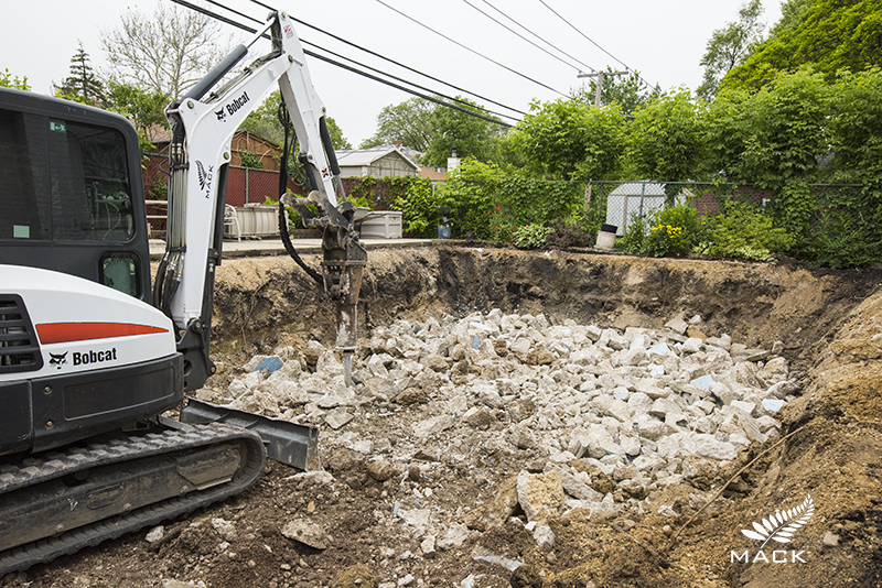 Mack Land Low Impact Pool Removal - Concrete is processed onsite into structural fill.